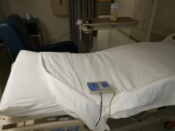 voice activated hospital bed pendant on bed
